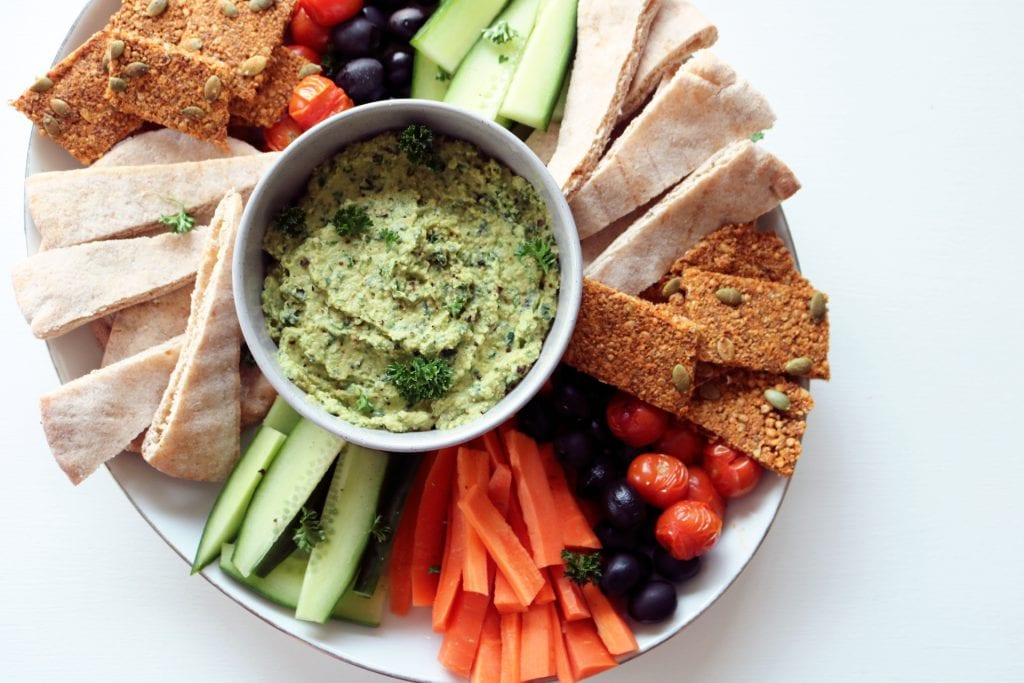 Plant based mezze board crackers herb hummus vegan vegetarian whole food recipe